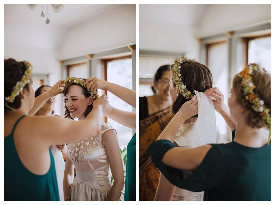 Champaign bride putting on her flower crown