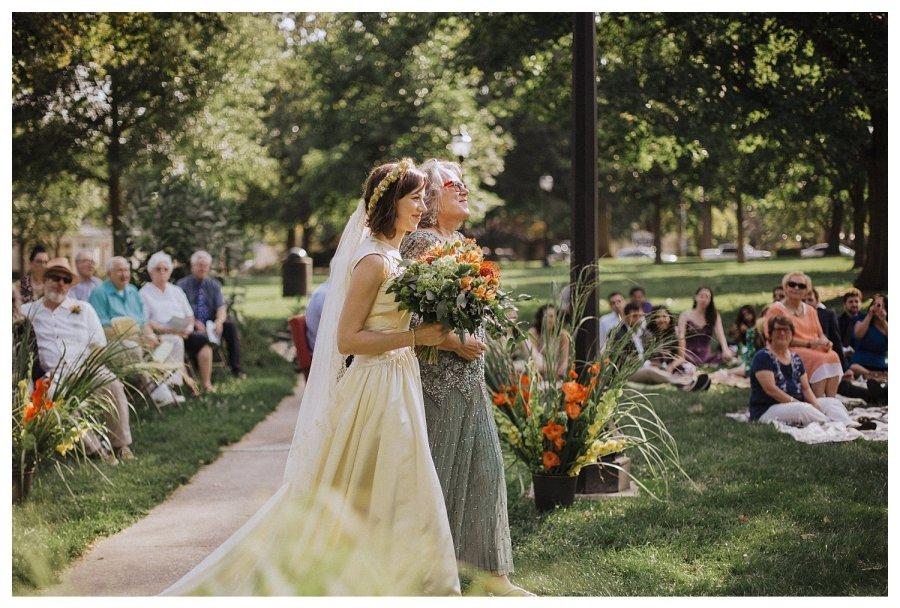 Champaign bride walking down aisle