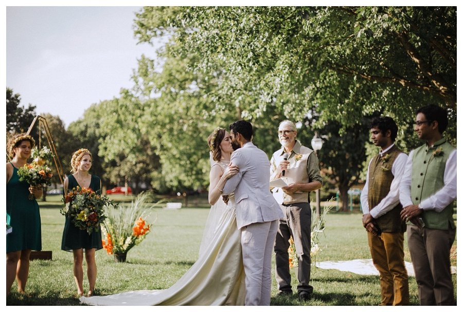 Outdoor Champaign wedding first kiss