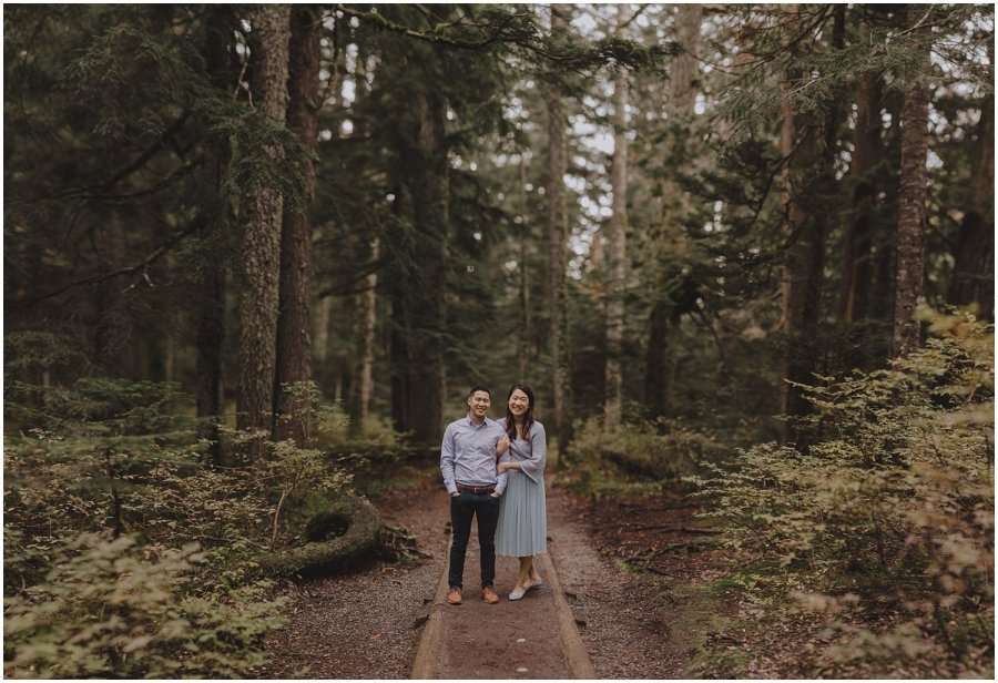 Couple standing in the woods in Snoqualmie Washington Engagement Session Seattle Wedding and Elopement Photographer Kyle Szeto