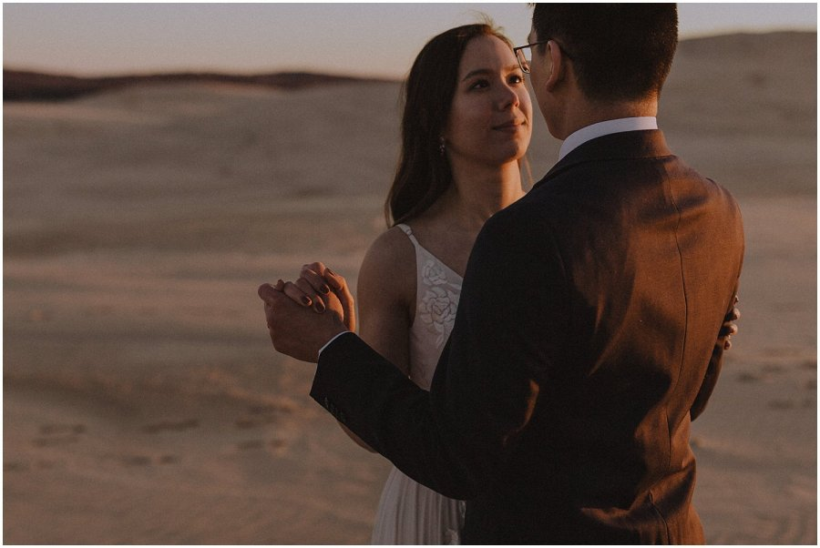 desert inspired elopement couple looking at one another