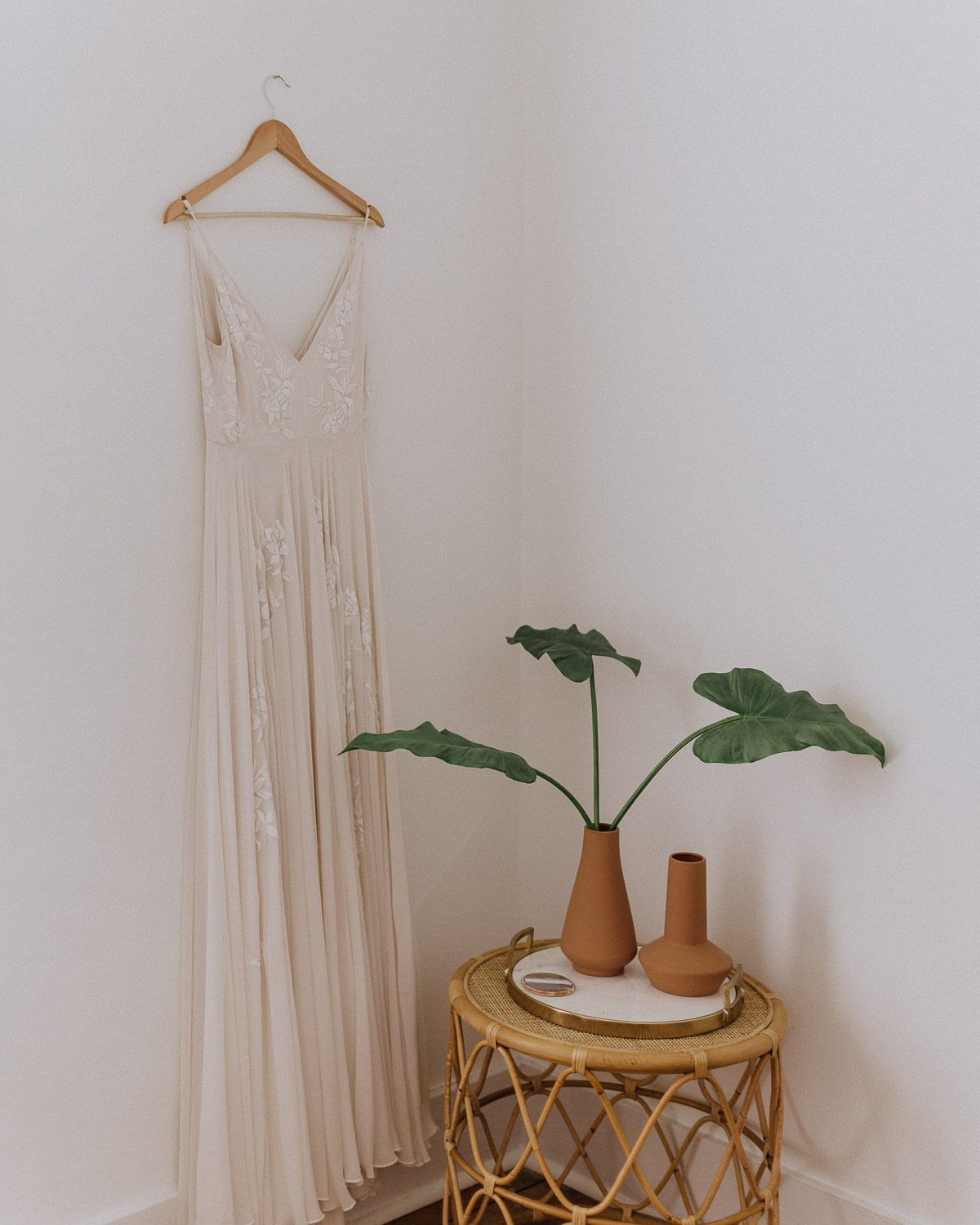 a wedding dress with a plant