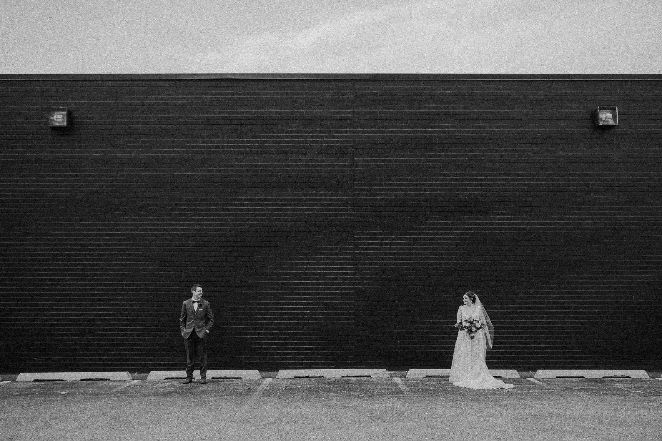 wedding couple walking towards a sunset