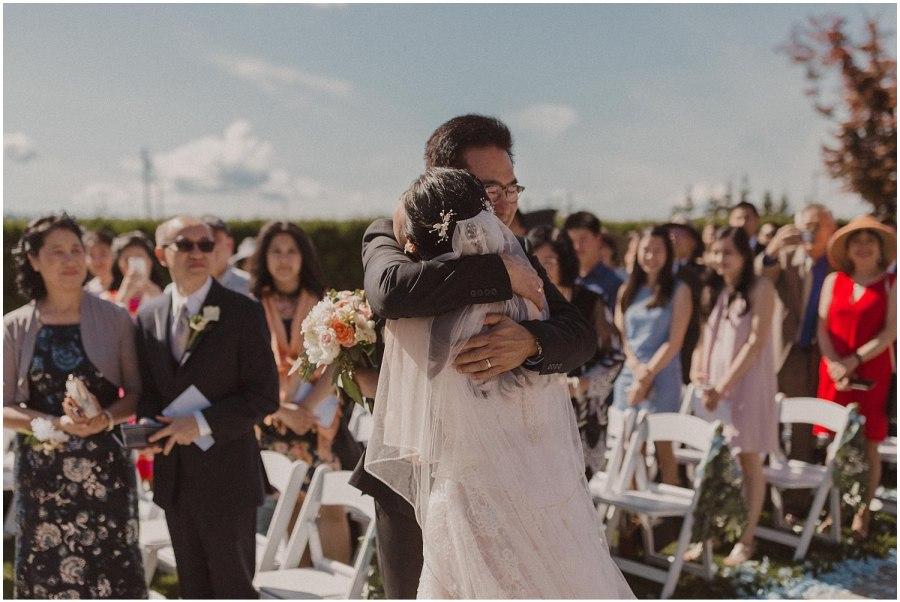 thomas family farm seattle snohomish wedding bride walking down the aisle