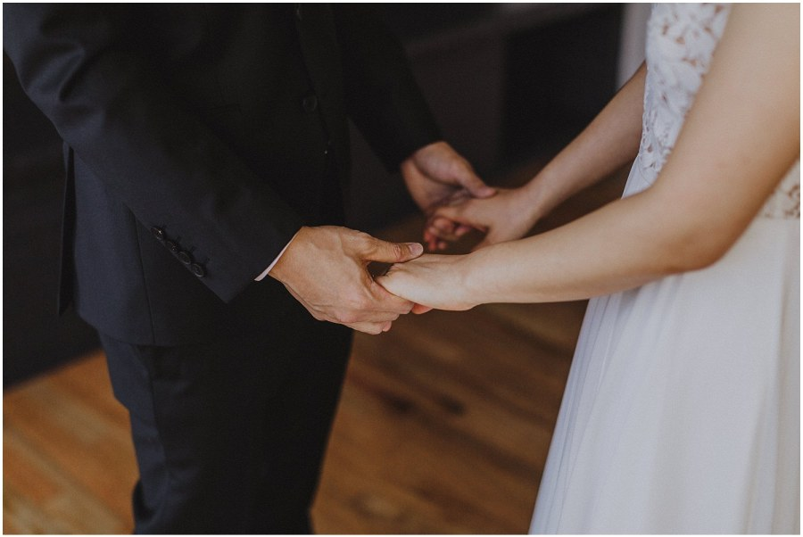 groom and bride holding hands Chicago wedding photographer kyle szeto