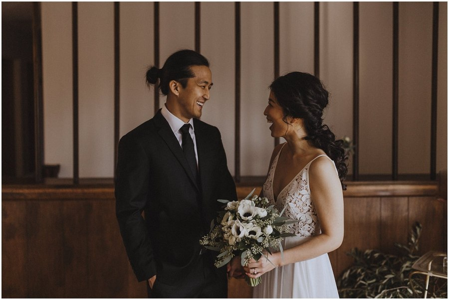 groom and bride smiling and laughing Chicago wedding photographer kyle szeto