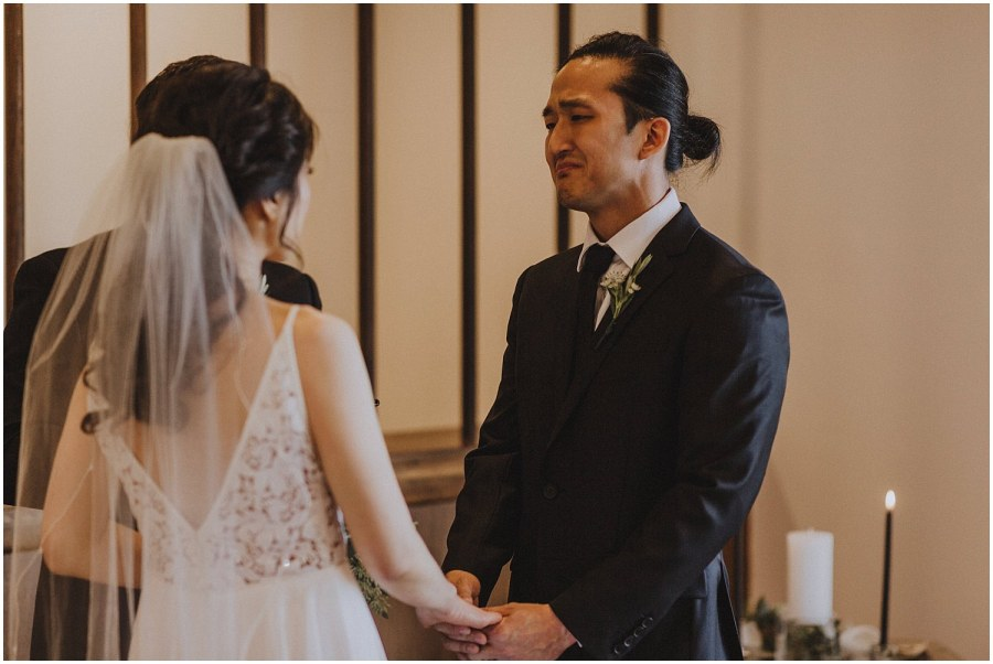 groom crying as he says his vows Chicago wedding photographer kyle szeto