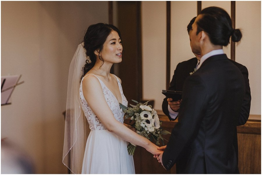 bride saying her marriage vows Chicago wedding photographer kyle szeto