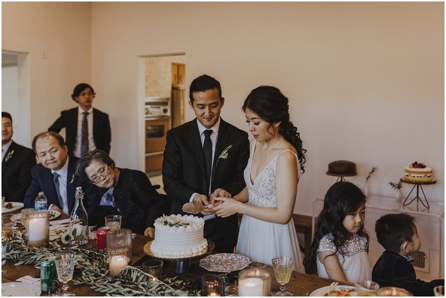 bride and groom cutting their wedding cake Chicago wedding photographer kyle szeto