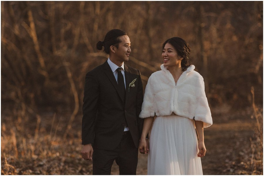 bride and groom walking together in the woods Chicago wedding photographer kyle szeto