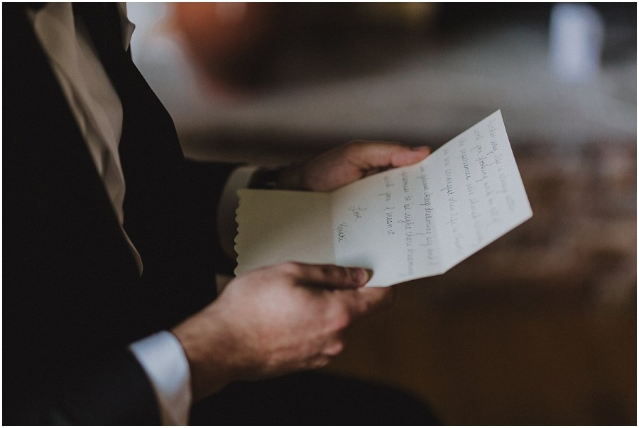 Groom reading letter Chicago wedding and elopement photographer Kyle Szeto