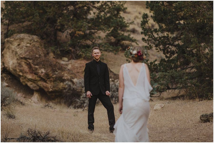 groom watching his bride walking down the aisle oregon elopement and wedding photographer kyle szeto