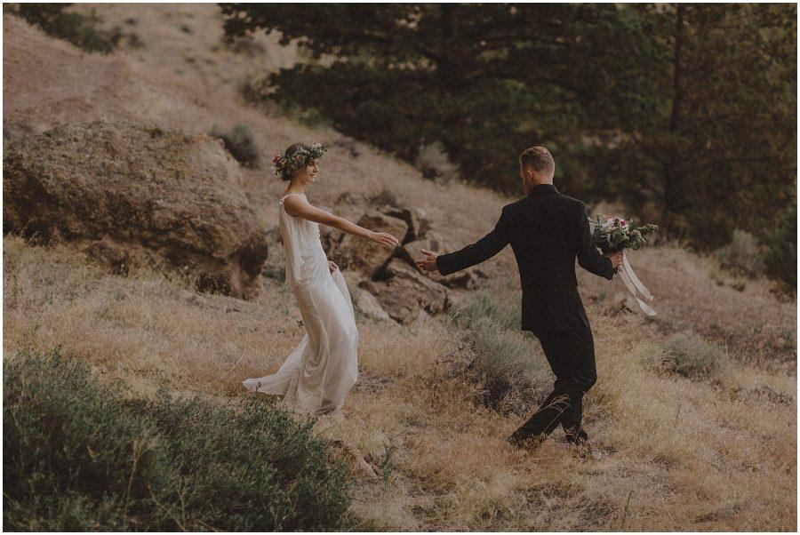 wedding couple walking down mountain at smith rock oregon elopement and wedding photographer kyle szeto