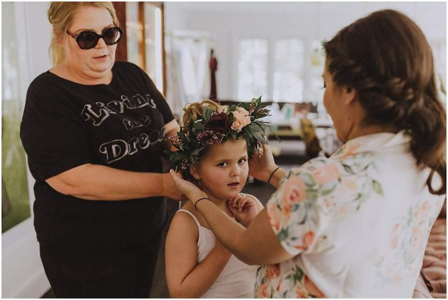 flower girl wearing a floral crown wisconsin wedding elopement photographer kyle szeto