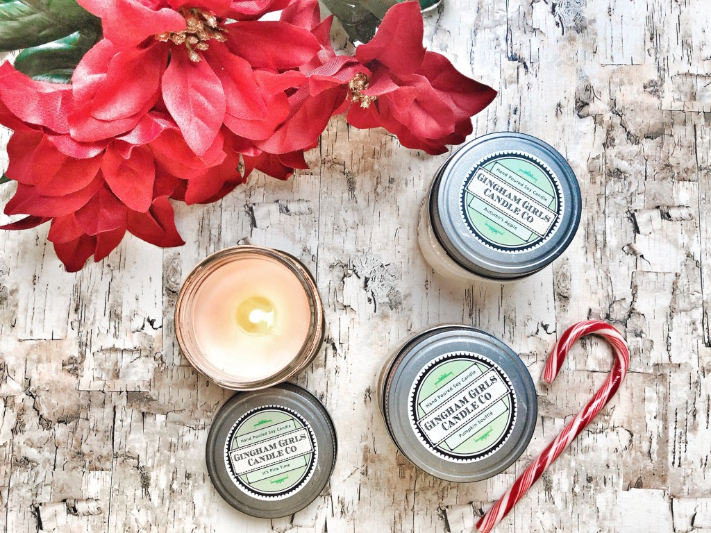 """Gingham Girls Candle Co. Everyone loves candles, right? I kind of get tired of the same typical scents. I was lucky enough to win a giveaway recently where I won three candles from Gingham Girls, and I was blown away! These gorgeous candles come in the cutest little tins and are high quality, hand-poured, eco-friendly soy candles made right here in the US! I have been lucky enough to try the scents """"Pumpkin Souffle"""" (which is as delectable as it sounds), """"Autumn's Apple"""" which is absolutely charming and utterly divine, and """"It's Pine Time"""" which is so nostalgic for me. Not only is it the PERFECT scent for Christmas, but it reminds me of running through the pine trees and playing at my grandparents' house as a kid. I love it SO much. Gingham Girls offers the option to buy candles in cute little gift sets or individually!"""