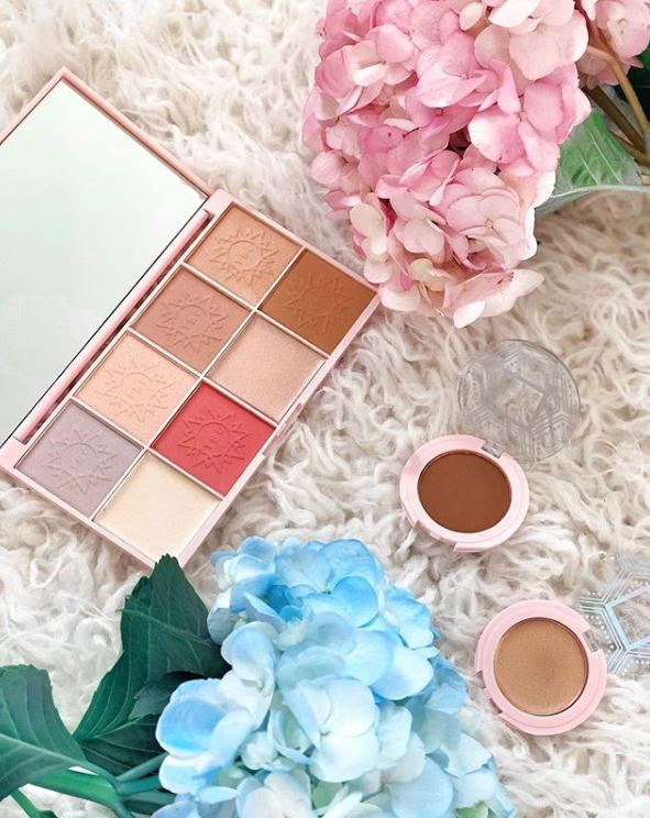 The Beauty Crop Travel Tea Face Palette in Mediterranean Spring, Staycation Bronzer Powder in Tanneries, and Staycation Highlight Powder in Perle de Sud