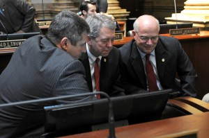 Even though the 2016 Legislative Session just convened last week -- on Tuesday, January 5 -- legislators are already hard at work. Above, Senate Democratic Floor Leader Ray S. Jones II (left), D-Pikeville, Senator Dorsey Ridley (center), D-Henderson, and Senator Dennis Parrett (right), D-Elizabethtown, research information pertaining to 2016 legislation while the Kentucky State Senate takes a brief recess. Among the work to be done during this 60-day session is the most daunting task of the General Assembly – the drafting of the state's two-year budget.