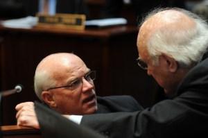 Senator Dennis Parrett (left), D-Elizabethtown, conferred with Senate Democratic Caucus Whip Julian M. Carroll, D-Frankfort, during early January on the floor of the Kentucky State Senate.