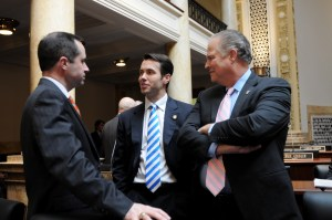 Senator Morgan McGarvey (center), D-Louisville, discusses legislation facing the 2016 Kentucky General Assembly with Senate colleagues today during a brief recess. Legislators could be voting on bills on the Senate floor as early as Thursday of this week.