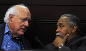 Senate Democratic Whip Julian M. Carroll, D-Frankfort, confers with Senate Democratic Caucus Chair Gerald A. Neal, D-Louisville, during the June meeting of the Interim Joint Committee on Veterans, Military Affairs, and Public Protection.