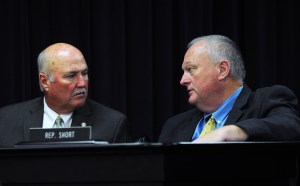Senator Johnny Ray Turner (left) confers with Rep. John Short during the Oct. 4 Interim Joint Committee on Transportation.