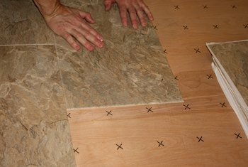 remove linoleum before laying tile