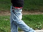 A US youngster wearing his pants