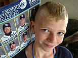 Tampa Bay Rays fan Zachary Sharples, 12, of Palmetto, Florida, displays his