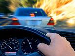 A motorist speeding through traffic (iStockPhoto)