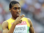 South Africa's Caster Semenya gestures as she crosses the finish line in the 800m semi-final race of the 2009 IAAF Athletics World Championships on August 17, 2009 in Berlin. AFP PHOTO / OLIVIER MORIN (Photo credit should read OLIVIER MORIN/AFP/Getty Images)