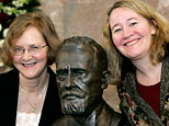 Elizabeth H. Blackburn from San Francisco, left, and Carol Greider from Baltimore pose next to a bust of Paul Ehrlich before they were awarded the Paul Ehrlich and Ludwig Darmstaedter science prize in Frankfurt, Germany. (AP)