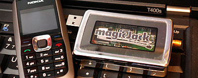 The new and improved MagicJack, is shown with a regular cellphone at the Consumer Electronics Show. (AP Photo/Paul Sakuma)