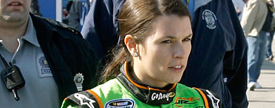 river Danica Patrick, right, leaves the garages surrounded by security personnel at Daytona International Speedway in Daytona Beach, Fla., Saturday, Feb. 13, 2010. (AP Photo/John Raoux)