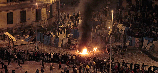 Pro-government demonstrators clash with anti-government demonstrators in Tahrir Square in Cairo, Egypt.