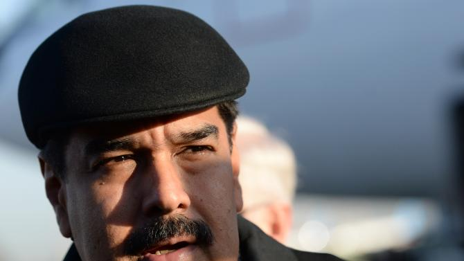 FILE - In this Friday, May 8, 2015, file photo, Venezuela's President Nicolas Maduro is on his arrival at Vnukovo airport in Moscow. Whether it's from corruption scandal or stagnant growth, the prospects for the crop of leftist Latin American presidents that have been running the region since the start of the millennium appear to be dimming. No leader has been harder hit than Venezuelan President Nicolas Maduro, who's approval ratings have tumbled amid the crisis to 28 percent, near the lowest in 16 years of socialist rule, and while there's no sign the sometimes violent street protests that overwhelmed the country a year ago will return anytime soon, polls indicate that the opposition will coast to victory in legislative elections expected to take place by year end. (RIA Novosti Pool Photo via AP, File)