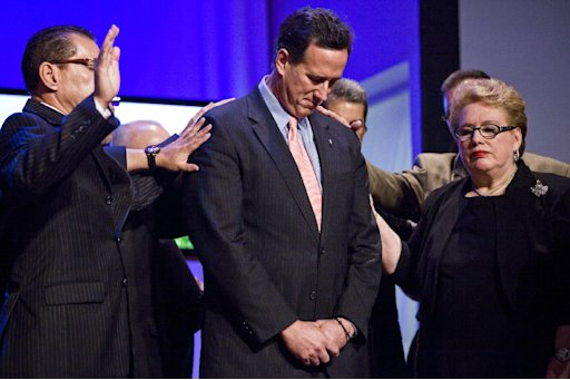 Rick Santorum (centre) attends a prayer service at the Path of the Cross church in San Juan, Puerto Rico, this week