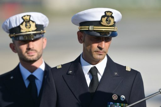 Italian marines Massimiliano Latorre (R) and Salvatore Girone (L) arrive at Ciampino airport near Rome, on December 22, 2012. Italy on Friday said it would send two marines on trial for murder in India back to the country, after earlier saying they would remain in Italy in a move that had unleashed a diplomatic furore