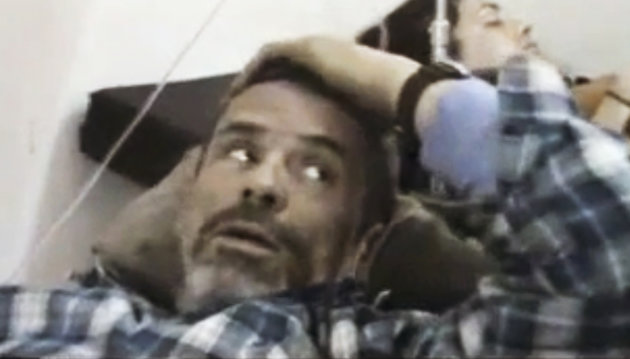 On this Thursday, Feb. 22, 2012 file image from amateur video made available by Shaam News Network purports to show Paul Conroy of the Sunday Times, laying wounded, in a makeshift clinic in Homs, Syri