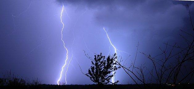 Lightning danced across the sky Wednesday, April 27, 2011 near Maysville, Ky. (AP Photo/The Ledger Independent, Terry Prather)