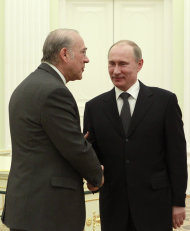 Russian President Vladimir Putin, right, shakes hands with Secretary-General of the Organization for Economic Cooperation and Development Angel Gurria during their meeting in the Kremlin in Moscow, Thursday, Feb. 14, 2013. (AP Photo/Maxim Shemetov, Pool)