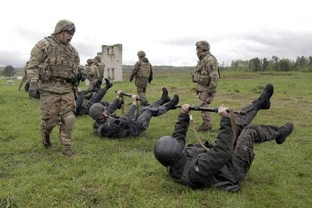 Servicemen of the U.S. Army's 173rd Airborne Brigade Combat Team train members of the Ukrainian National Guard during a joint military exercise...