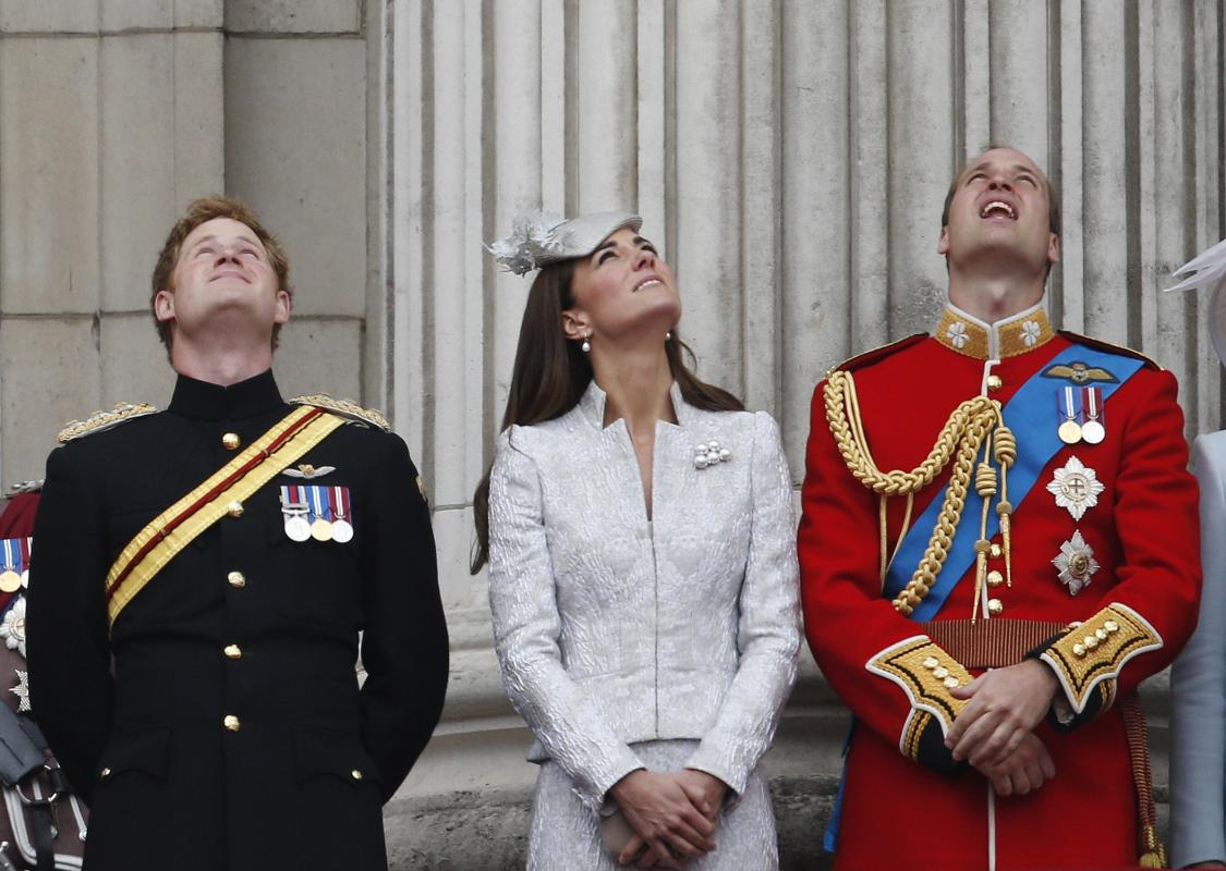 "From left, Britain's Prince Harry, Kate, Duchess of Cambridge, and Prince William, watch a Royal Air Force fly past, as they appear on the balcony of Buckingham Palace, during the Trooping The Colour parade, in central London, Saturday, June 14, 2014. Hundreds of soldiers in ceremonial dress have marched in London in the annual ""Trooping the Colour"" parade to mark the official birthday of Queen Elizabeth II. ""Trooping the Colour"" originated from traditional preparations for battle, when flags were carried or ""trooped"" down the rank for soldiers to see. (AP Photo/Lefteris Pitarakis)"