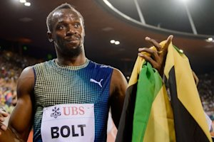 Usain Bolt celebrates after winning the men's 100m …