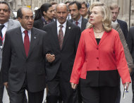 Secretary of State Hillary Rodham Clinton talks with with Libyan Transitional National Council chairman Mustafa Abdel Jalil, center, and Libyan Transitional National Council Prime Minister Mahmoud Jibril during a walk to the Elysee Palace in Paris, Thursday, Sept. 1, 2011. (AP Photo/Evan Vucci, Pool)