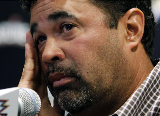 Miami Marlins manager Ozzie Guillen listens to a question during  a news conference at Marlins Stadium in Miami, Tuesday April 10, 2012. Guillen has been suspended for five games because of his comments about Fidel Castro. He has again apologized and says he accepts the punishment.  (AP Photo/Lynne Sladky)