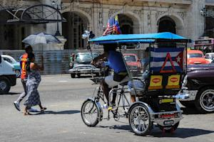 A US flag adorns a pedicab in Havana, Cuba, on April …
