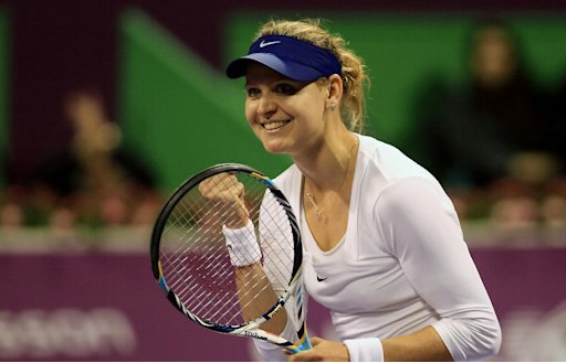 Lucie Safarova of the Czech Republic celebrates after beating Caroline Wozniacki of Denmark