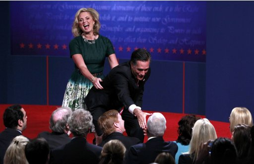 Ann Romney grabs Republican presidential nominee Mitt Romney from behind as he greets members of the crowd after the conclusion of the final U.S. presidential debate in Boca Raton