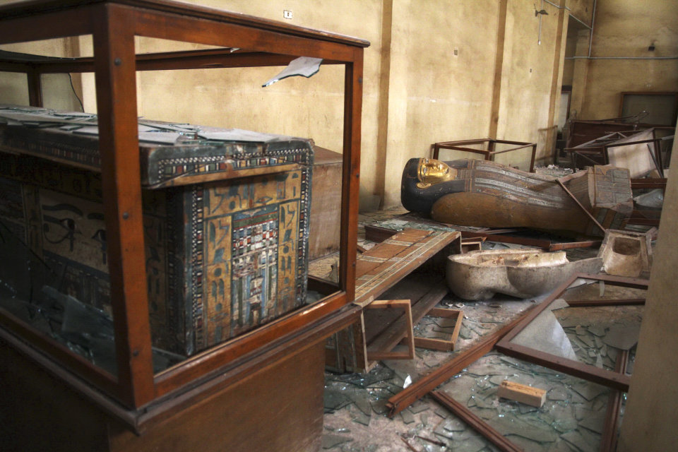 FILE -- In this Saturday, Aug. 17, 2013 file photo, Damaged pharaonic objects lie on the floor and in broken cases in the Malawi Antiquities Museum after it was ransacked and looted between the evening of Thursday, Aug. 15 and the morning of Friday, Aug. 16, 2013, in Malawi, south of Minya, Egypt. The theft of about 1,000 artifacts spanning some 3,500 years of history from a small antiquities museum south of Cairo showcases the tenuous security in the provinces. (AP Photo/Roger Anis, El Shorouk Newspaper, File) EGYPT OUT
