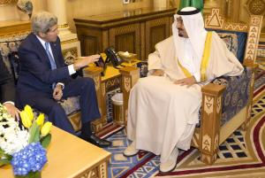 U.S. Secretary of State John Kerry, left, meets with…